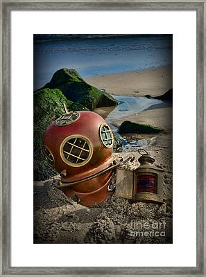 The Helmet And The Lantern Framed Print by Paul Ward
