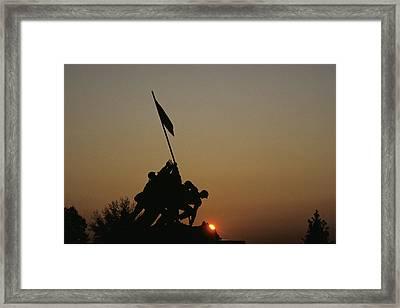 The Iwo Jima Memorial Silhouetted Framed Print by Kenneth Garrett