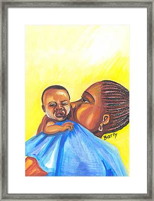 The Kiss Of A Mother In Senegal Framed Print by Emmanuel Baliyanga
