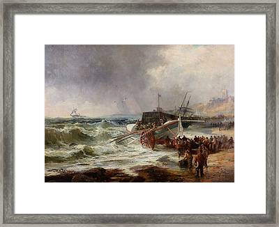 The Lifeboat Heading Out In Rough Seas Framed Print by Robert Ernest