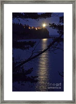 Framed Print featuring the photograph The Light Shines Through by Larry Ricker