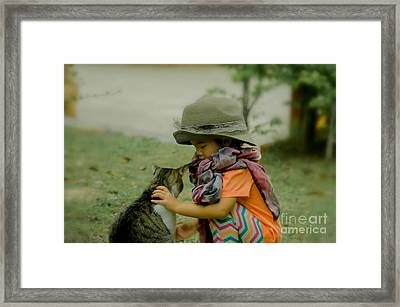 The Little Girl And Her Cat Framed Print
