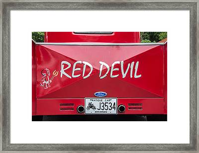 The Little Red Devil Framed Print