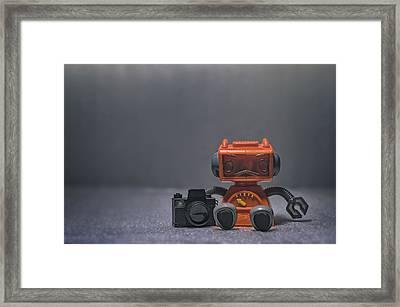 The Lonely Robot Photographer Framed Print