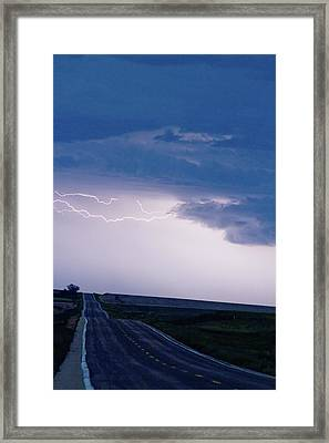 The Long Road Into The Storm Framed Print