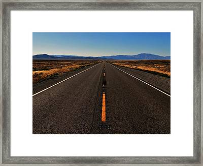 The Lonliest Road Framed Print