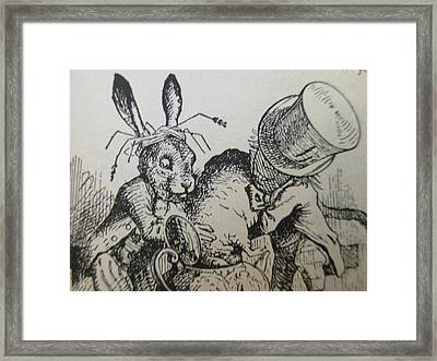The Mad Hatter And The March Hare Try To Put The Dormouse Into The Teapot Framed Print by David Lovins