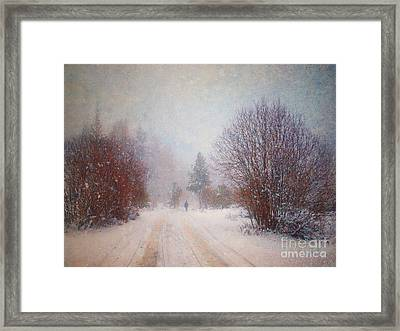 The Man In The Snowstorm Framed Print by Tara Turner