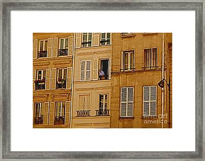 The Man In The Window Framed Print by Louise Fahy