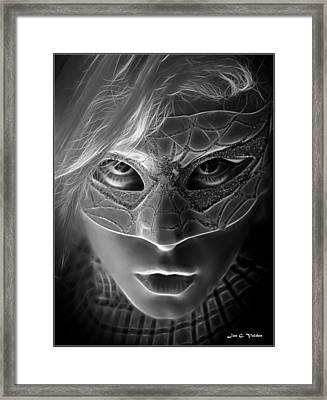 The Mask Of The Spider Woman Framed Print