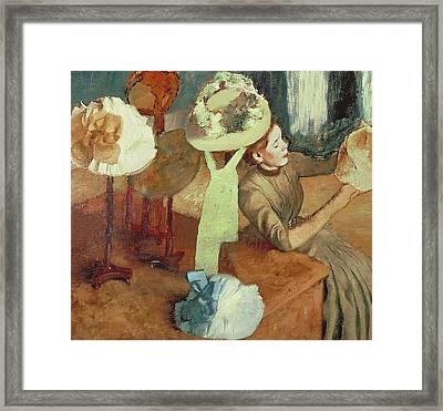 The Millinery Shop Framed Print by Edgar Degas