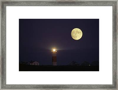 The Moon Shines Above The Sankaty Head Framed Print by James L. Stanfield
