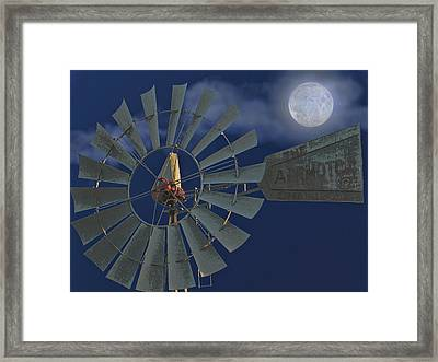 The Moon Spinner Framed Print