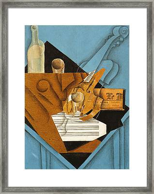 The Musician's Table Framed Print by Juan Gris