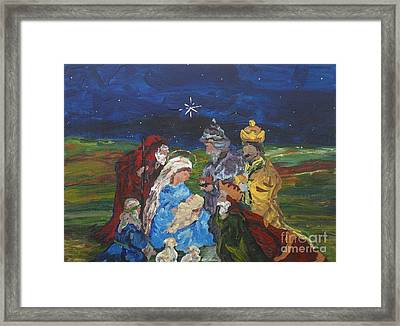 The Nativity Framed Print by Reina Resto