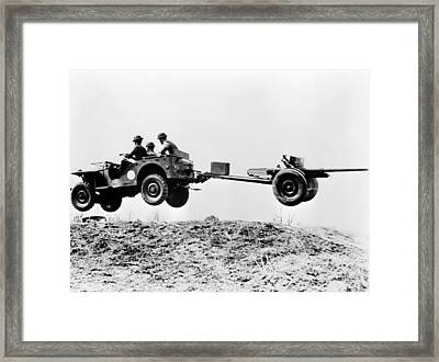 The New Jeep In Mid-air As It Pulls Framed Print by Everett