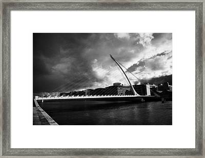 the new Samuel Beckett Bridge across the river liffey in Dublin republic of ireland under dark grey  Framed Print by Joe Fox