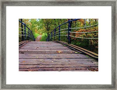 the old bridge over the river invites for a leisurely stroll in the autumn Park Framed Print