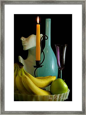 Framed Print featuring the photograph The Orange Candle by Elf Evans