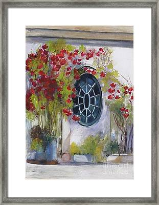 The Oval Window Framed Print