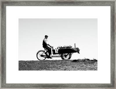 The Peddler Framed Print