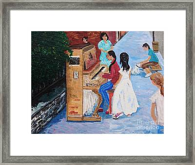 The Piano Player Framed Print by Reb Frost