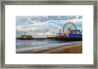 The Pier On A Cloudy Day Framed Print