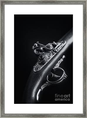 The Pistol Framed Print