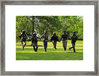 The Puddle Jumpers At Byers Choice Framed Print by Trish Tritz