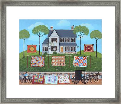 The Quilt Parade Framed Print by Mary Charles