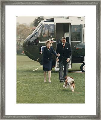 The Reagans Being Greeted By Their Dog Framed Print by Everett