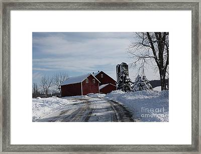 The Red Barn In The Snow Framed Print