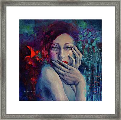 The Red Bird Framed Print