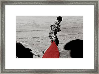 The Red Cape Framed Print