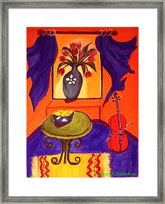 The Red Cello Framed Print
