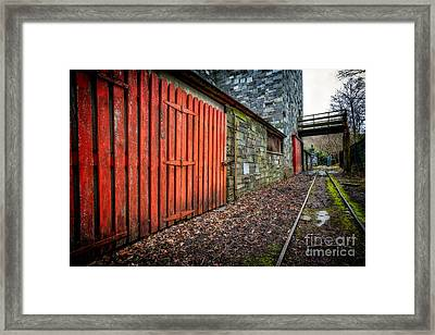 The Red Gate Framed Print by Adrian Evans