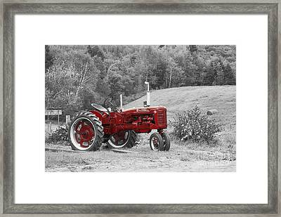The Red Tractor Framed Print
