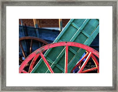 The Red Wagon Wheel Framed Print