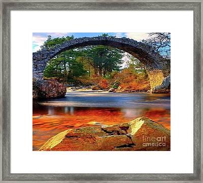 The Rock Bridge Framed Print by Rod Jellison
