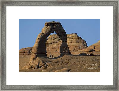 The Scale Of Delicate Arch Framed Print by Stan and Anne Foster