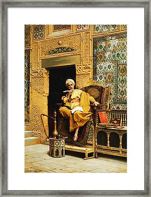 The Scribe Framed Print by Ludwig Deutsch