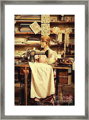 The Seamstress At Work Framed Print by Priscilla Burgers