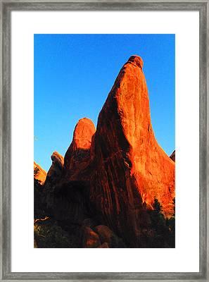 The Shady Side Of Orange Rock Framed Print by Jeff Swan
