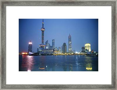 The Shanghai Skyline And Riverfront Framed Print