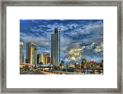 The Skyscraper And Low Clouds Dance Framed Print by Ron Shoshani