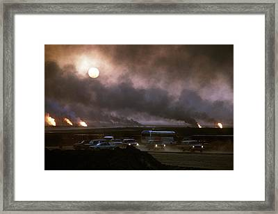 The Smoke From Oil Well Fires Forces Framed Print