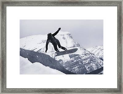 The Snowboard Championships Were Held Framed Print by George F. Mobley
