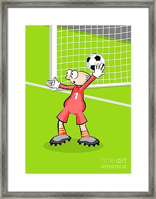 The Soccer Goalkeeper Takes The Ball In His Hands To Make A Serve Framed Print