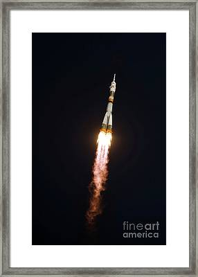 The Soyuz Tma-13 Spacecraft In Flight Framed Print by Stocktrek Images