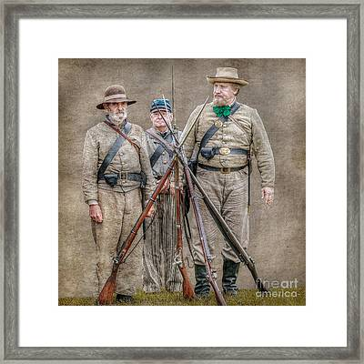 The Stacking Of Arms Framed Print by Randy Steele